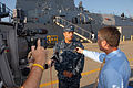 The Arleigh Burke-class guided-missile destroyer USS Mason (DDG 87) commanding officer, Cmdr. Adan Cruz speaks to media prior to departing Naval Station Norfolk in advance of Hurricane Irene 110825-N-PS473-003.jpg