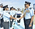 The Chief of Air Staff, Air Chief Marshal N.A.K. Browne congratulates the newly commissioned Flying Officers and welcomes them into the IAF fraternity during the Combined Graduation Parade at Air Force Academy, Dundigal.jpg