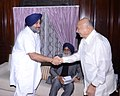The Deputy Chief Minister of Punjab, Shri Sukhbir Singh Badal calls on the Union Home Minister, Shri Sushil Kumar Shinde, in New Delhi on October 29, 2012. The Chief Minister of Punjab, Shri Prakash Singh Badal is also seen.jpg