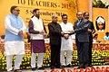 The President, Shri Pranab Mukherjee presenting the National Award for Teachers-2015 to Shri Gokul Prasad Banjare (Chhattisgarh), on the occasion of the 'Teachers Day', in New Delhi.jpg