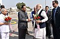The Prime Minister, Shri Narendra Modi being received by the Governor of Gujarat and Madhya Pradesh, Shri O.P. Kohli and the Chief Minister of Gujarat, Shri Vijay Rupani, on his arrival, in Ahmedabad, Gujarat (1).jpg