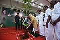 The Prime Minister, Shri Narendra Modi planting sapling to mark the Commencement of Massive Tree Plantation Programme, at Kalaivanar Arangam, in Chennai.jpg
