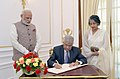 The Prime Minister of the Democratic Socialist Republic of Sri Lanka, Mr. Ranil Wickremesinghe signing the visitors' book, at Hyderabad House, in New Delhi (2).jpg