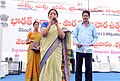 The Social Welfare Officer, Ms. Ranga Laxmi, addressing the gathering, at the Bharat Nirman Public Information Campaign at Bhadrachalam, in Khammam District, Andhra Pradesh on December 16, 2013.jpg