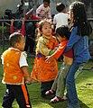 Tibetan boy in orange chuba.jpg
