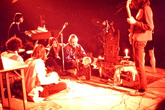 Nikon F - Example of a Nikon Photomic FTn image – Timothy Leary, family, and band (1969).