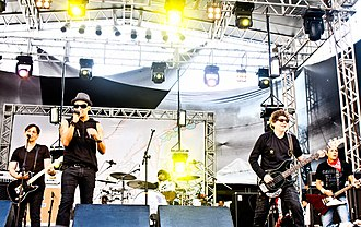 Titãs - Titãs live in 2012. From left to right: Paulo Miklos (former member), Sergio Britto, Mário Fabre (session member), Branco Mello, and Tony Bellotto