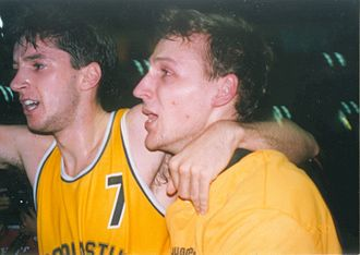 Dino Rađa - Rađa celebrates winning Split's second consecutive continental title with teammate Toni Kukoč, after beating FC Barcelona at the FIBA European Champions Cup Final Four final game in Zaragoza on 19 April 1990.