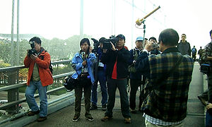 TVB News - TVB reporter Joyce Fung and the station's photographers, shown covering the 2005 WTO protests in Hong Kong.