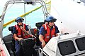 Two sailors try out the USCGC Charles Sexton's jet boat., 2014 01 28 -b.jpg