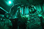 U.S. Air Force Tech. Sgt. Richard Mulhollen, right, a C-130H Hercules aircraft loadmaster with the 774th Expeditionary Airlift Squadron, gives the signal to begin a cargo airdrop over Ghazni province 131007-F-YL744-067.jpg