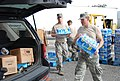 U.S. Airmen with the 259th Air Traffic Control Squadron, Louisiana National Guard (LANG) distribute food, water and ice to citizens in need of resources in New Orleans Sept 120901-A-SM895-078.jpg