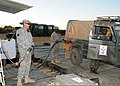 U.S. Army Pfc. Ronnie Okello, center, a fuel handler with Alpha Company, 405th Brigade Support Battalion, Illinois Army National Guard, fuels a vehicle for the Botswana Defence Force as Sgt. Kaleb Sperry, left 120809-Z-VI159-164.jpg