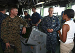 U.S. Marine Corps Lt. Col. Chris S. Richie, left, commander of Special-Purpose Marine Air-Ground Task Force Continuing Promise 2010 (CP10) and U.S. Navy Capt. Thomas M. Negus, center right, commodore of CP10 100821-M-PC721-263.jpg