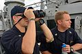 U.S. Navy Chief Master-at-Arms Jason Morris, left, stands watch monitoring civilian merchant traffic aboard the guided missile destroyer USS Ross (DDG 71) in the Dardanelles en route to the Black Sea Sept 140903-N-IY142-089.jpg