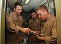 U.S. Navy Lt. Cmdr. Brian Hansen, left, assigned to Patrol Squadron (VP) 8, reviews a P-3C Orion aircraft circuit breaker book with Naval Aircrewman (Operator) 2nd Class David Scudder while Lt. j.g. Brent 140110-N-CW427-008.jpg