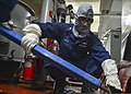 U.S. Navy Machinist's Mate 1st Class David Paez practices shoring techniques during a general quarters drill aboard the guided missile cruiser USS Monterey (CG 61) May 18, 2013, in the Persian Gulf 130518-N-QL471-076.jpg
