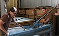 U.S. Navy Utilitiesman 1st Class Jennifer Bacon, left, and Builder 2nd Class Michelle Dablemont, both with Naval Mobile Construction Battalion 15, prepare duct work during a project supporting Combined Special 130527-A-CV700-012.jpg