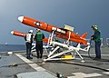 U.S. Sailors assigned to the targets detachment at Fleet Activities Okinawa, Japan, check a BQM-74 target drone on the flight deck of the amphibious dock landing ship USS Tortuga (LSD 46) during a missile 130525-N-IY633-099.jpg