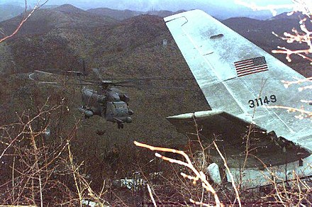 USAF MH-53J Pave Low helicopter over wreckage of the USAF CT-43A approximately 3 kilometers north of the Dubrovnik Airport in Croatia, April 4, 1996. USAF CT-43A crash 1996.jpg