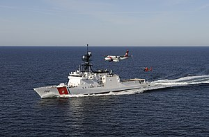 Maritime patrol - A United States Coast Guard cutter with one of the force's maritime patrol aircraft and a helicopter