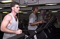 US Navy 021104-N-5152P-001 Sailors exercise on treadmills.jpg