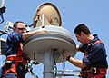 US Navy 021107-N-4374S-019 SITE TV antenna maintenance aboard USS Nassau.jpg
