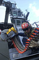 US Navy 021114-N-4142G-003 A sailor guides 20mm rounds while loading the Close-In Weapons System (CIWS.jpg
