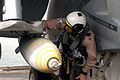 US Navy 030327-N-6817C-064 A U.S. Naval Aviator assigned to Strike Fighter Squadron One Fifteen (VFA-115) inspects precision-guided ordnance attached to an F-A-18E Super Hornet aboard USS Abraham Lincoln (CVN 72).jpg