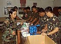US Navy 050219-N-6775N-004 U.S. Army and Philippines medical personnel unpack pharmaceuticals in a school classroom prior to medical relief efforts during exercise Balikatan 2005 in Infanta, Philippines.jpg