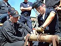 US Navy 050727-N-8825R-011 Hull Technician Fireman Brandon Jackson, right, and Damage Controlman 3rd Class Seth Lindauer demonstrate pipe-patching techniques.jpg