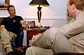 US Navy 060503-N-5174T-024 Actor Gary Sinise discusses the impact of visiting deployed Sailors with Commander, Carrier Strike Group Seven, Rear Adm. Michael Miller.jpg