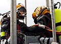 US Navy 070130-N-3178C-002 Navy Diver 2nd Class Ryan Steinkamp and Senior Chief Hospital Corpsman Michael Bowe-Rahming steady themselves on a dive platform aboard the rescue and salvage ship USS Safeguard (ARS 50) during at-anc.jpg