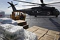 US Navy 070907-N-1810F-006 A Sailor aboard multi-purpose amphibious assault ship USS Wasp (LHD 1) prepares to load Meals Ready-to-Eat (MREs) onto an CH-53E Super Stallion.jpg