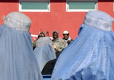 Cmdr. Adrienne Simmons speaking at the 2008 ceremony for the only women's mosque in Khost City, a symbol of progress for growing women's rights in the Pashtun belt. US Navy 080123-N-3385W-028 Cmdr. Adrienne Simmons, medical provider for Provincial Reconstruction Team Khost and only woman on the team, speaks at the groundbreaking ceremony for a women's mosque and park in downtown Khost City.jpg