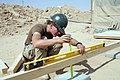 US Navy 080606-N-9623R-414 Builder 2nd Class Kathryn Henderson, assigned to Naval Mobile Construction Battalion (NMCB) 3, uses a horizontal level and tape measure.jpg