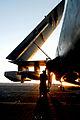 US Navy 080620-N-6538W-098 Aviation Electronics Technician 3rd Class Stephen Guz tightens tie-down chains on an EA-6B Prowler following flight operations aboard the aircraft carrier USS John C. Stennis (CVN 74).jpg