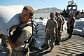 US Navy 080912-N-4515N-300 Service members embarked aboard the amphibious assault ship USS Kearsarge (LHD 3) unload food and supplies for delivery to areas affected by recent hurricanes.jpg