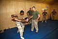 US Navy 081011-N-9623R-012 Seabees earn the Marine Corps Martial Arts Program (MCMAP) tan belt.jpg