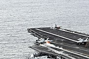 US Navy 081124-N-3659B-305 F-A-18C Hornets launch from the Nimitz-class aircraft carrier USS Ronald Reagan (CVN 76)