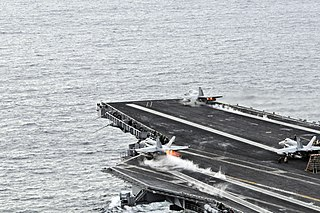 aircraft takeoff and landing using catapult assistance for takeoff and barrier or wire arrest for landing, typically aboard an aircraft carrier