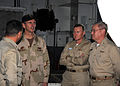 US Navy 090119-N-7571S-001 Adm. Jonathan W. Greenert speaks with Capt. Ladd Wheeler, right, CO of the aircraft carrier USS Theodore Roosevelt (CVN 71), Rear Adm. Frank Pandolfe, commander, CSG-2, and Cmdr. Aaron Stanley, Supply.jpg