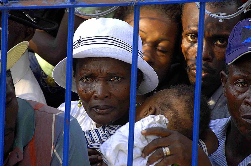 File:US Navy 090418-F-7923S-023 A Haitian woman waits her turn for treatment at the Killick medical clinic site during a Continuing Promise community medical service project.jpg