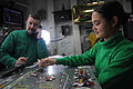 US Navy 090721-N-4995K-002 Aviation Electronics Technician Airman Patricia Hansen moves aircraft templates around the Ouija board in flight deck control aboard the aircraft carrier USS Ronald Reagan (CVN 76).jpg