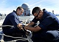 US Navy 090910-N-7280V-187 Boatswain's Mate Seaman Robert Daub and Gunner's Mate Seaman Don Flores splice Kevlar mooring lines.jpg