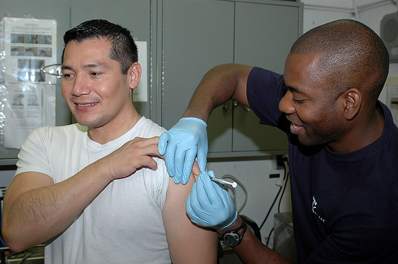 File:US Navy 091129-N-8960W-064 Hospital Corpsman Michael Parke gives a vaccine to Lt. Carlos Lopez aboard the aircraft carrier USS Nimitz (CVN 68).jpg