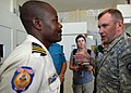 US Navy 100120-N-6639M-002 Lt. Gen. P.K. Keen, commander of Joint Task Force Haiti, visits Azistude Rosemond, chief of police in Cite De Soleil, Haiti.jpg