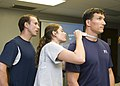 US Navy 100129-N-6674H-004 Mark McFarland, a fitness program coordinator for Navy Region Hawaii, observes Cryptologic Technician (Interpretive) 2nd Class Shannon Forbes as she performs a body composition assessment.jpg