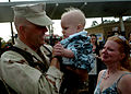 US Navy 100418-N-4440L-099 Lt. Gregory Hazlett is welcomed home by his wife and holds his son for the first time at Naval Construction Battalion Center, Gulfport.jpg