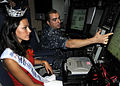 US Navy 100819-N-3560G-002 Electricians Mate 1st Class Allan Kleaving, assigned to the Virginia-class attack submarine USS Hawaii (SSN 776), explains basic submarine operations to Jalee Kate Fuselier, Miss Hawaii 2010.jpg